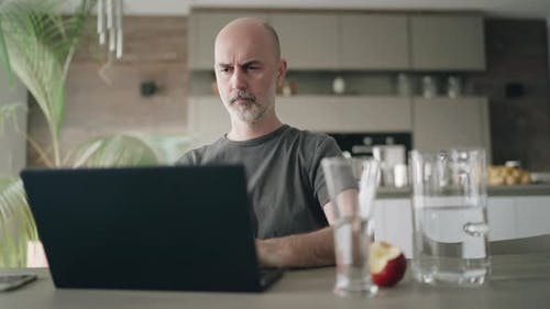 Covid-19 Curfew Concentrated Man Working From Home at Laptop