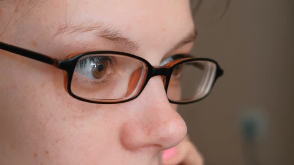 Thumbnail for Woman in Glasses Is Speaking Mobile Phone and Looking Ahead