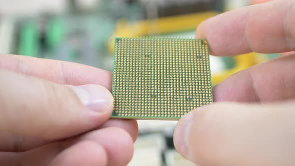 Thumbnail for Worker Holds Computer CPU Processor