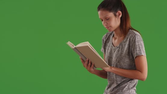 Thumbnail for Intelligent white girl reading literature book standing indoors green screen