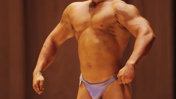 Athlete With Ripped Muscles and Strong Body Standing on Stage, Bodybuilding