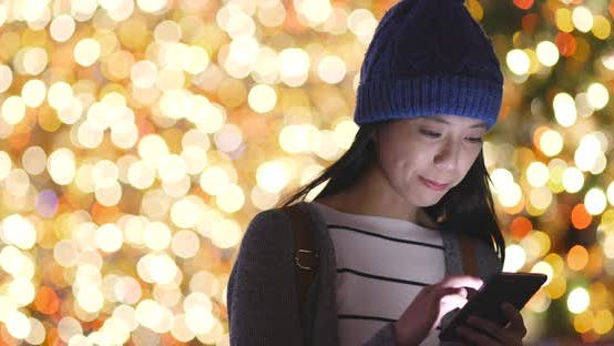 Thumbnail for Woman use of smart phone over bokeh background