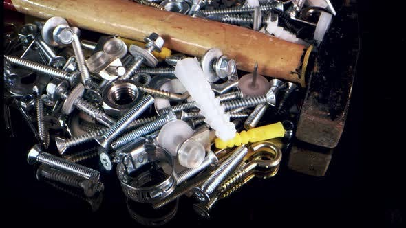 Stainless Steel Bolts Screws Dowels Nails And Nuts And Hammer