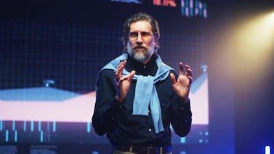 Mature Bearded Speaker Explaining Financial Strategy