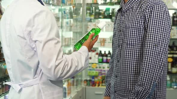 Thumbnail for Doctor Giving Bottle of Mouth-wash To Patient and Shaking Hands