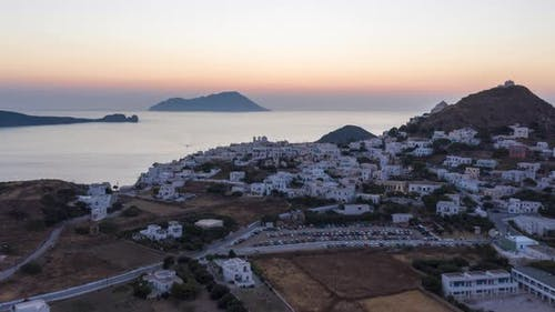 Aerial Hyper Lapse Above Typicall Greek Village at Sunset Overlooking the Aegean Sea, Cyclades