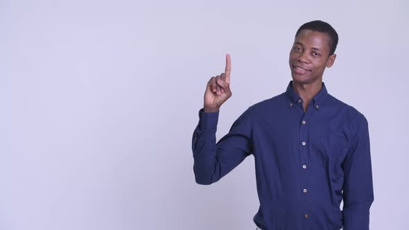 Young Happy African Businessman Thinking and Pointing Up