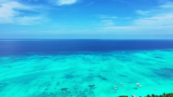 Thumbnail for Beautiful birds eye copy space shot of a white sand paradise beach and aqua blue ocean background