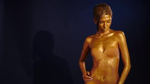 Shining Woman Painted with Gold