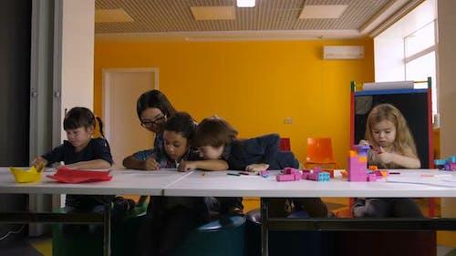 Diverse Kindergarten Pupils Learning at Classroom