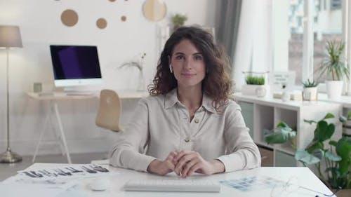 Clothes Designer Presenting Sketches Online