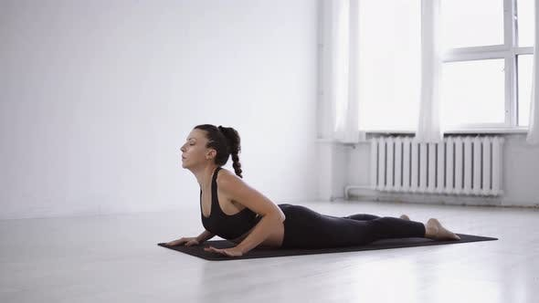 Thumbnail for Flexible caucasian brunette woman practice morning yoga postures doing stretching