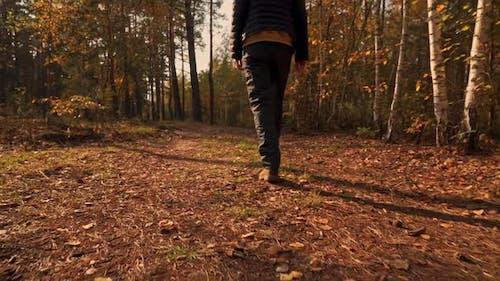 Unrecognizable Female in Casual Boots Walks