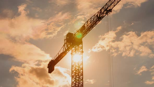 Thumbnail for Silhouette of Tower Crane in Sun Light Working on Construction Site Sunny Evening Warm Color Heaven