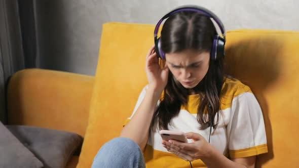 Thumbnail for Girl Enjoys the Music in Earphones