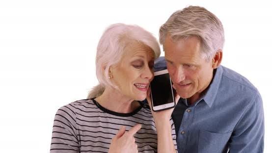 Thumbnail for Senior couple using smartphone on white background