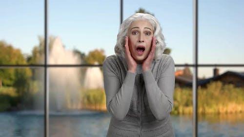 Senior Woman Making Shouting Gesture