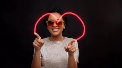 Woman in Sunglasses Dancing with Glowing Lines