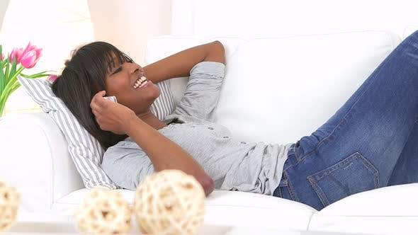 Thumbnail for Happy black woman talking on smart phone