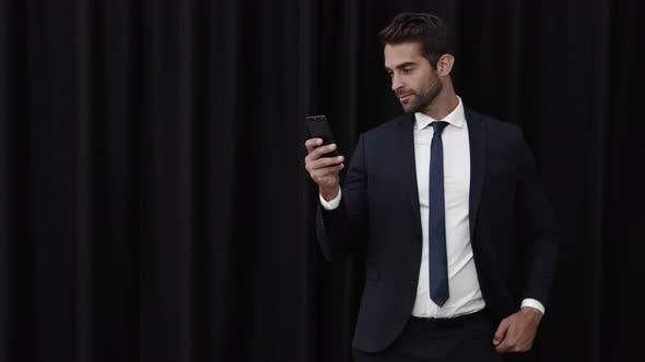 Thumbnail for Businessman Checking Cell Phone