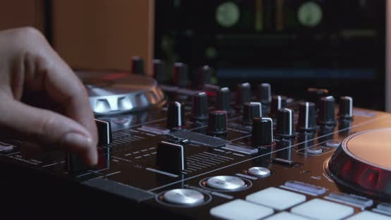 Thumbnail for Hands Of DJ Controlling Digital Mixer 06B