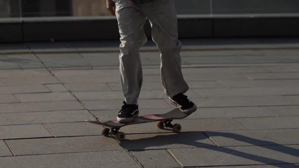 Thumbnail for Legs of Skater Doing Kickflip Trick Outdoors