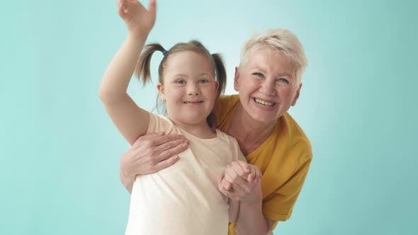 Thumbnail for Smiling Aged Woman and Her Handicapped Granddaughter