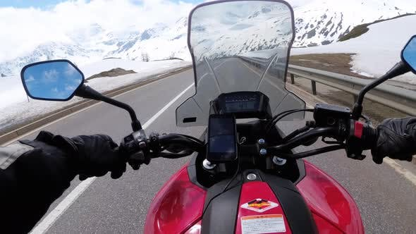 Thumbnail for Motorcyclist Rides on Beautiful Landscape Snowy Mountain Road Near Switzerland Alps