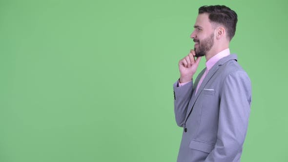 Thumbnail for Profile View of Happy Young Bearded Businessman Thinking