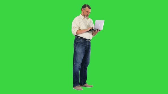 Thumbnail for Senior Businessman Working with Laptop on a Green Screen Chroma Key