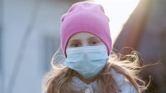 Thumbnail for Girl Wearing Medical Mask During Coronavirus COVID-19 Epidemic