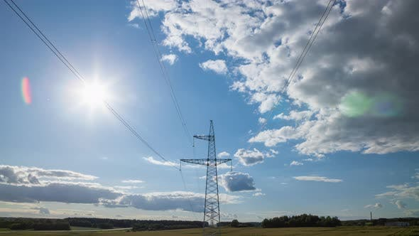 Thumbnail for Power Transmission Lines High Voltage Electricity Grid with Cloudy Blue Sky and Sun Beams on