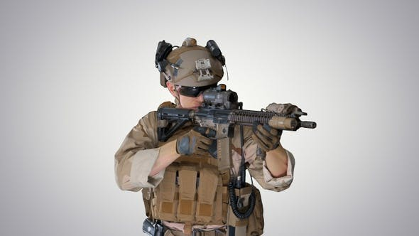 United states ranger aiming with assault rifle while walking