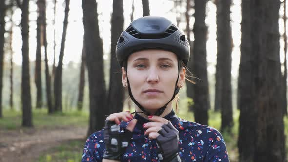 Thumbnail for Cyclist puts on cycling helmet