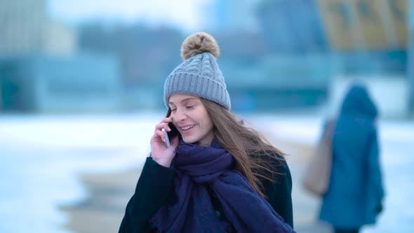 Young Girl Talking Phone Cold Winter