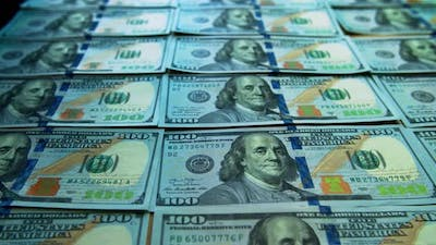 American one hundred dollar paper money pile on office desk. Concept of finance and money payment.