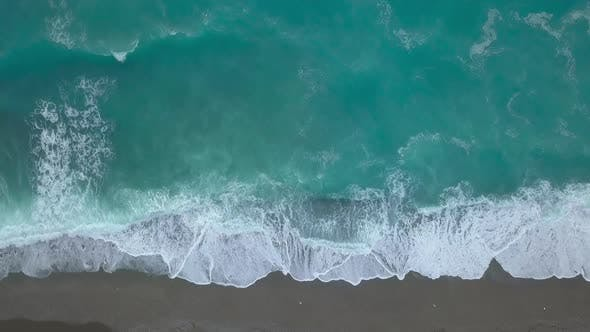 Thumbnail for Aerial Top View Turquoise Sea Waves Break on Empty Sand Beach, Clean Sea Waves From Bird's Eye View
