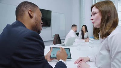 Business Analysts Working with Growth Graph in Office