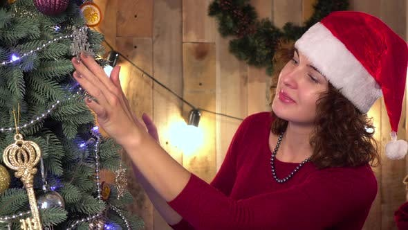 Thumbnail for Woman Decorate the Christmas Tree in a House Interior