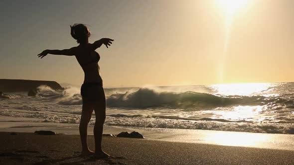Thumbnail for Standing on sandy beach