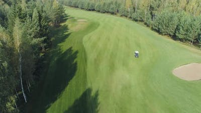 Summer Sunny Day Aerial View of Golf Course in Forest Area Golf Club Electric Golf Car Rides on the