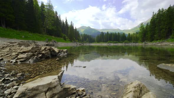 Cover Image for Forest and Mountain Range Reflection on Pond, Austria