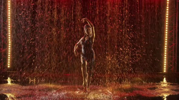 Happy Wet Woman Passionately Dancing Flamenco in the Rain. Graceful Hand Movements in Slow Motion