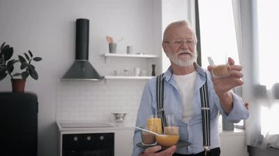 Wholesome Products, an Elderly Smiling Man in Glasses for Vision, Who Cares About Health, Talks