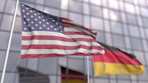 Flags of the United States and Germany in Front of a Skyscraper