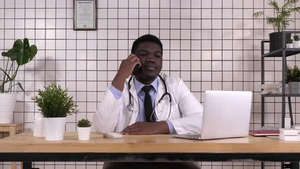 Thumbnail for Concentrated Male Doctor Making a Call