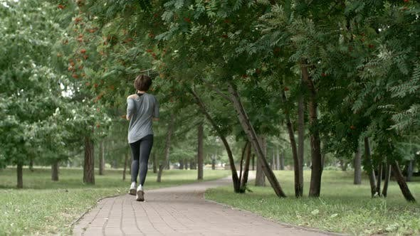 Thumbnail for Rear View of Woman Running in Park