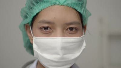 Close Up Portrait of a caucasian doctor or nurse with face mask.