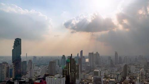 Sunburst or sun rays or god light beam through the cloud over Bangkok city center – Time Lapse