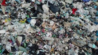 Plastic in the mountains, Mountain garbage, large garbage pile, degraded garbage.